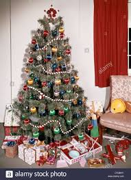 1960s DECORATED CHRISTMAS TREE WITH ORNAMENTS GARLAND TINSEL PRESENTS TOYS