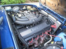 bmw e30 m20 with red ireland engineering spark plug wire set and crinkle coated intake manifold
