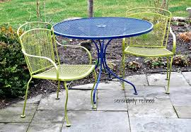 two tone 3 pc wrought patio furniture with blue round table and 2 lime armchairs
