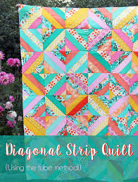 Diagonal Strip Quilt Tutorial | Cluck Cluck Sew & How to make a Diagonal Strips Quilt using the fast and fun tube method! Adamdwight.com