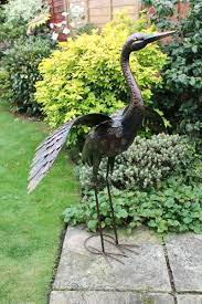 large bronze crane with wings down
