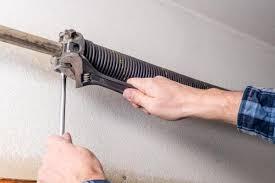 garage door extension spring repair and tightening