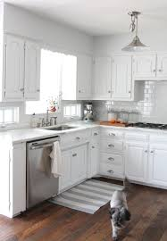 White Kitchen White Floor We Did It Our Kitchen Remodel Cabinets Countertops And Tile