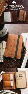 the dakota vine leather field notes wallet cover outed with an elastic strap to