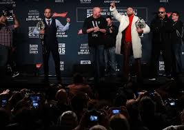 ufc lightweight champion ed alvarez and ufc featherweight champion conor mcgregor of ireland square up for