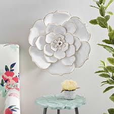 white metal blooming flower wall