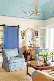 Living Room With Blue Barn Door