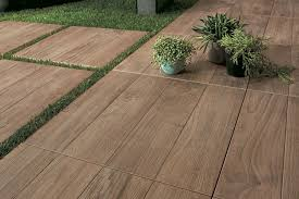 wood look outdoor tile as stepping stones or a garden path