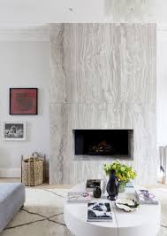 modern marble fireplace via thouswellblog