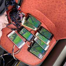 Uncle using multiple phones to play Pokemon Go, chargers and all:  SingaporeRaw