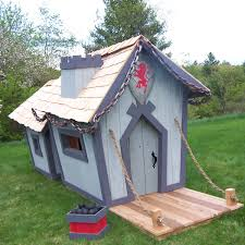 front side view of crooked castle playhouse with accessories