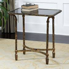 uttermost metal end table with inset black glass top tarnished gold leaf finish bistro and chairs