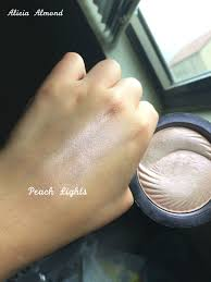 this is the makeup revolution baked highlighter in peach lights