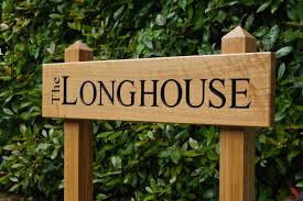 wooden house signs crafted by hand in surrey