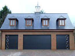 three anthracite carteck solid ribbed steel sectional garage doors two with porthole windows