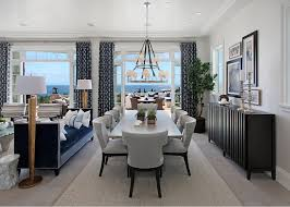 ocean view dining room with a large chandelier dining room with westbury