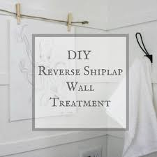 try this diy reverse shiplap wall treatment for an alternative to regular shiplap