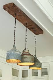 Image Fixer Up Salvaged Tractor Funnel Chandelier Love The Rustic Wood Eclecticallyvinta Dining Room Lighting Pinterest Rustic Farmhouse Kitchen Pendant Lighting Home Decor Pinterest