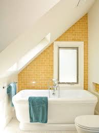 view in gallery tub with yellow brick wall in attic
