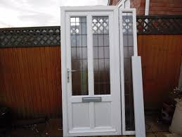 anglian white upvc double glazed front door and side panel c w leaded glass units