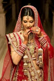 gorgeous royal bride in red dress gold jewellery
