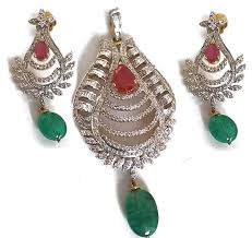 very nice diamond pendant made with 14k solid gold and studded with fine quality of excellent diamonds and ruby pears it has green onyx hangings