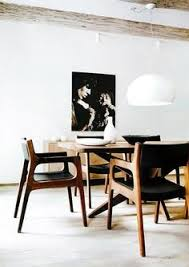 fl l designed by ferrucio laviani for kartell starfish dinning table and dear de autoban wooden chairs for de la espada