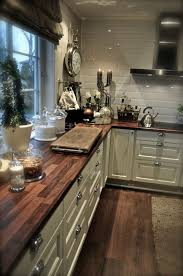 love the white cabinets an the wood counter tops i want this in