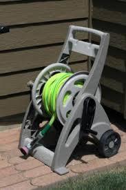 garden hose caddy. Garden Hose On A Reel Caddy