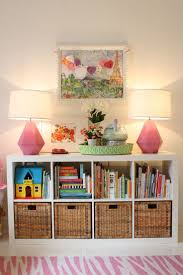GENIUS IDEA: Ikea Expedit Shelves with baskets for storage -- could work  ANYWHERE in the house! - book and toy storage in living room?