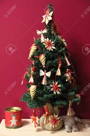 Small Christmas tree with traditional Finnish raffia decorations Stock  Photo - 17235824