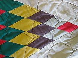 Lakota Star Quilt & Quilt tip: Do not fold and store a precious heirloom quilt as the fold  lines weaken the fabric. It is best to always use the