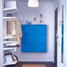 ikea hallway furniture. blue shoe cabinets together with white wall shelves in the hallway give room a focal point and make for useful place to store shoes when you come ikea furniture