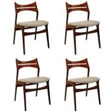 vine teak dining chairs by erik buch