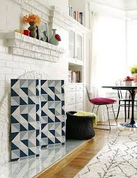 diy fireplace screen made from wallpaper not to be used when the fireplace is lit