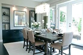 chandelier over dining table beach style dining