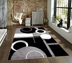 this geometric design includes circles and rectangles for a contemporary pattern it s available in gray white black blues purples black red white