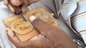 sandal wood carving artist working at his home in churu rajasthan india you