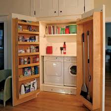 view in gallery large cabinets hiding laundry with extra functional doors for extra storage