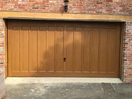 double garage doorConverting two single garage doors to a double  South East Garage