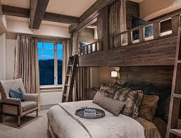these beautiful wooden bunk beds are built into the wall having the three rustic beds gives you more places to fit more people if you have a large family