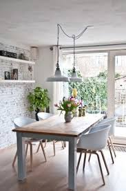 white rustic dining table. a relaxing dining room with industrial pendant lights over the white rustic table foter