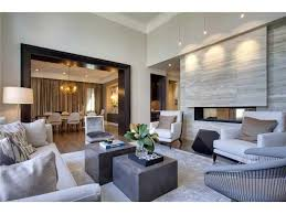 Contemporary living room - cool stone, grey and beige accented door frame  in black by