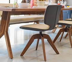beautiful luxury two tone leather dining chair with a swivel wood base