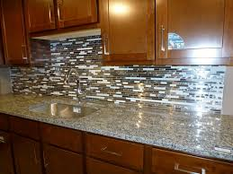 dark mahogany kitchen base wall and drawer with grey granite and drop in sink plus custom mosaic backsplash tiles