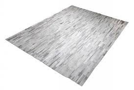 grey and white patchwork cowhide rug in stripes