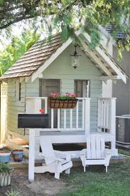DIY Outdoor Playhouse idea for kids, including accessories like flowers,  lights, furniture and