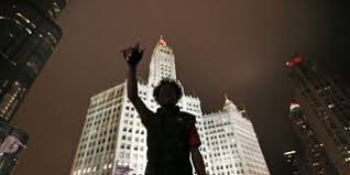 essay why i refuse to raise my son in chicago a protester is silhouetted against chicago s famed wrigley building as he directs others to shutdown traffic on both sides of the michigan ave bridge over