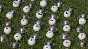 ball markers. tin cup ball markers