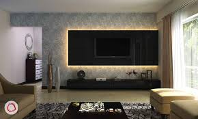 a contemporary wall design with a back lighting is quite popular now it adds a layer of aura in the room if you havea great wallpaper or a wall design